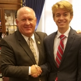 Congressman Thompson shaking hands with a young man in his office